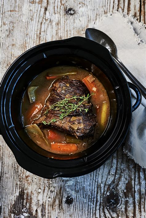 slow cooker brisket recipe  red wine thyme  onions