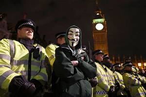 Police Clash With Anonymous Mask Demonstrators