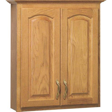 oak bathroom wall cabinets shop project source 25 5 in w x 29 in h x 7 5 in d golden