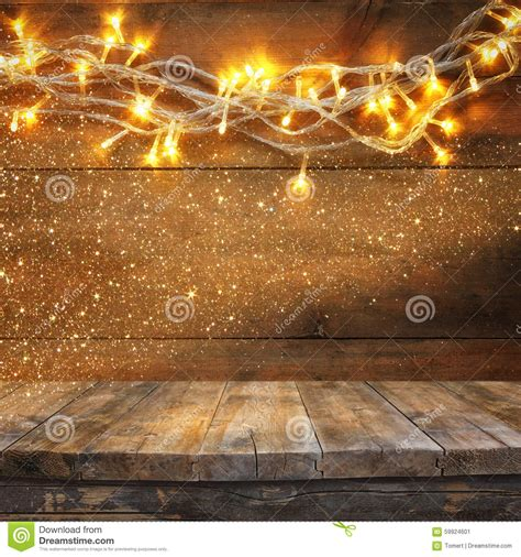 wood board table in front of warm gold garland