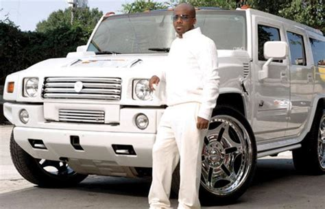 andre     rappers flexing  giant car