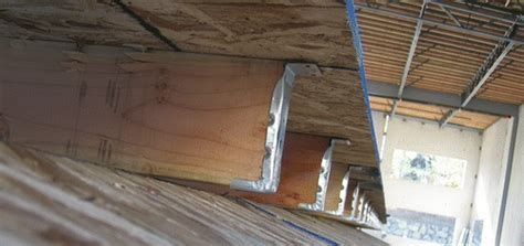 wood panelized roof subpurlin hanger construction defect