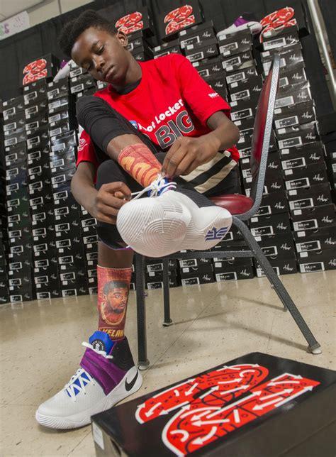 foot locker kyrie irving donate  pairs  sneakers