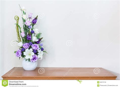 white flower table l artificial flower vase on wooden table and white wall