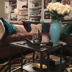 cozy brown couch with teal accents turquoise and brown
