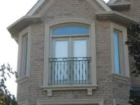 stucco window mouldings on brick exterior