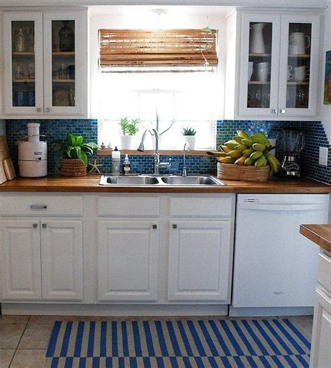 butcher block counter tops  blue  white kitchen