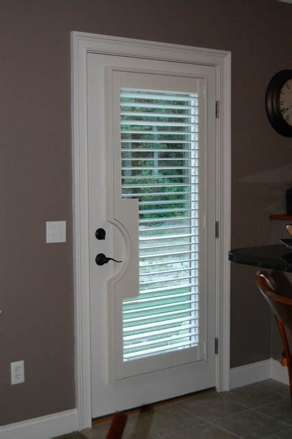 Patio Door Window Treatment Ideas by Plantation Shutters Traditional Basement Boston By