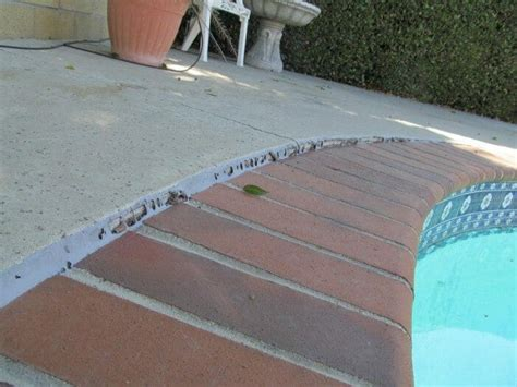 cracked  shifted pool coping
