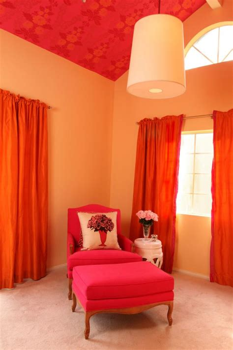 bright transitional sitting area features hot pink chair