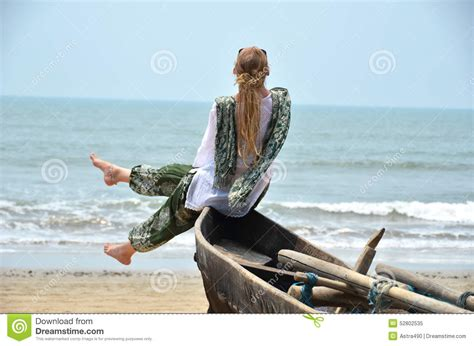Girls On Boats by Girl Sitting On The Old Fishing Boat Stock Photo Image