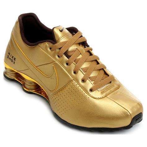 nike shox 02 nike shox deliver gold blue