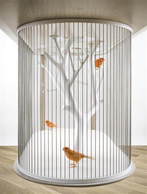 modern birdcage design also doubles as a table