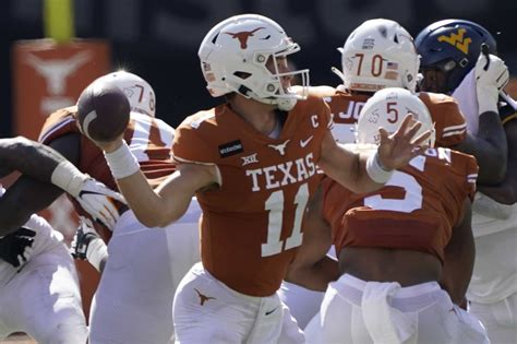 No. 22 Texas holds off West Virginia