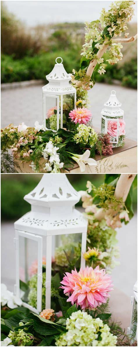 White lanterns pink dahlias spring wedding décor
