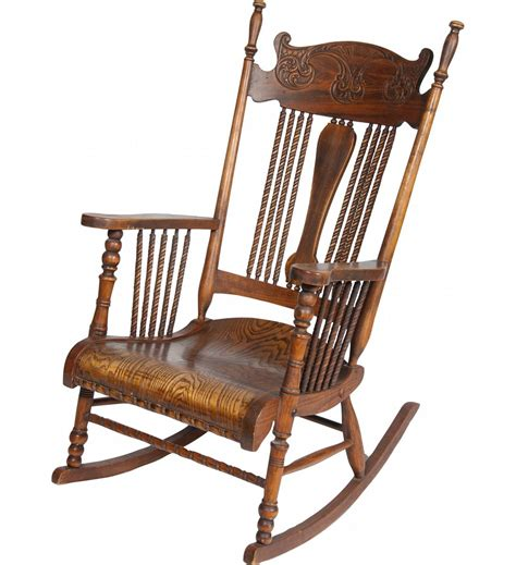 carved oak ornate rocking chair w armrests
