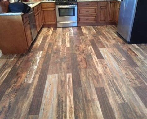 Laminate wood flooring in kitchen  light, medium and dark