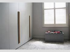 Smooth 'Shallows' fitted wardrobe in family townhouse in