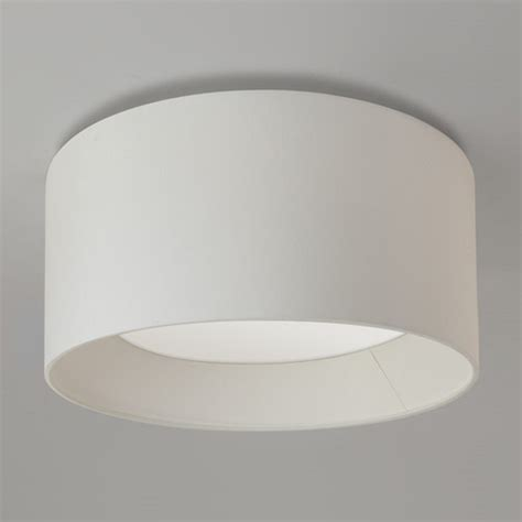 large flush fitting ceiling light with white fabric