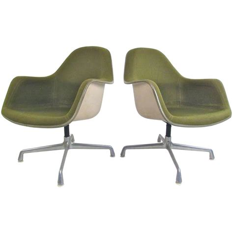 pair of mid century herman miller swivel shell chairs by