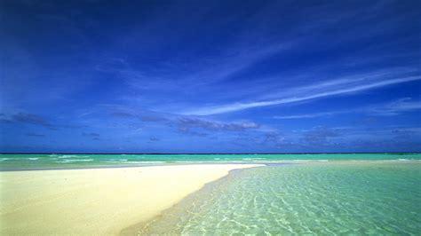 sandy beach shallow blue sea sky summe wallpaperscom