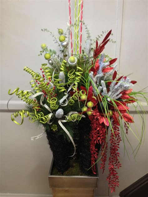 funky christmas urn arrangement  covered porch