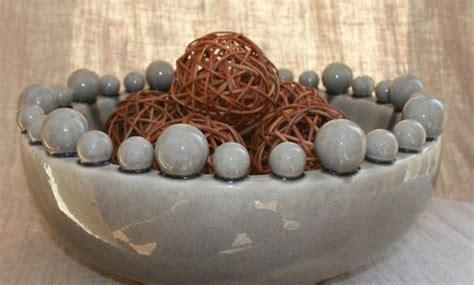 large grey ceramic bowl  bobbles  rim