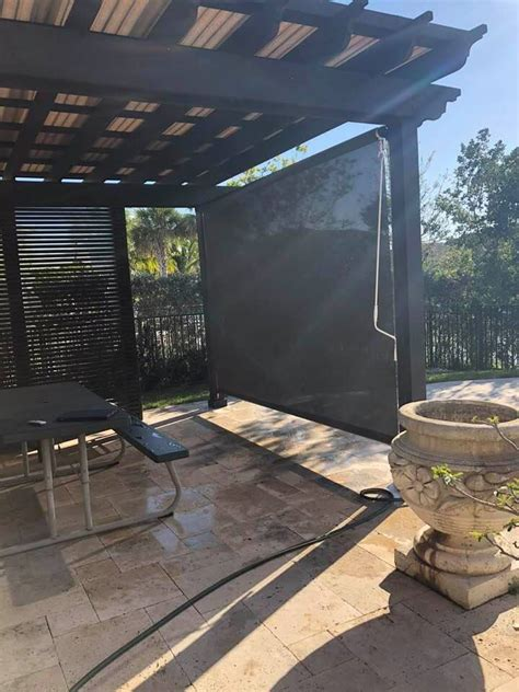 manual retractable patio shades   motorized retractable screens