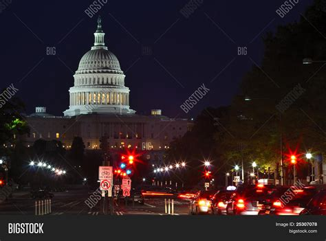 capitol building at with and car lights