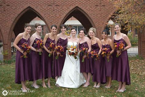 Bridesmaids In Purple Dresses With Orange And Purple