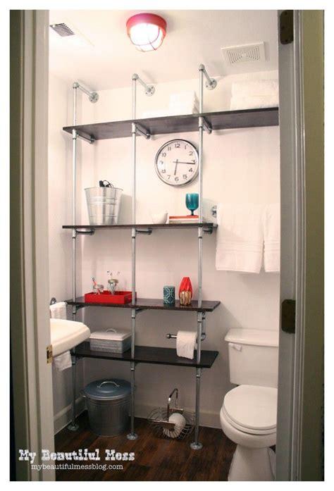 epic bathroom makeover  galvanized pipe shelving unit