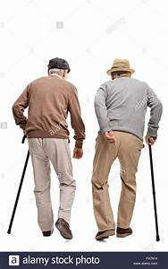 Two elderly people walking with canes isolated on white ...