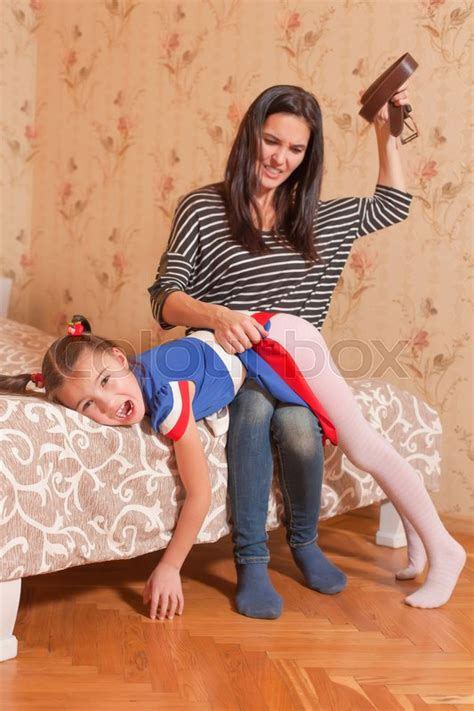 angry mother beat   daughter  belt strict
