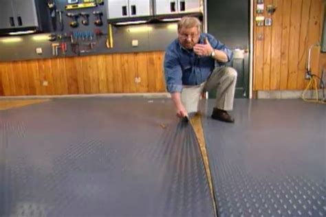 How to Put Down a Roll Out Floor Covering in a Garage