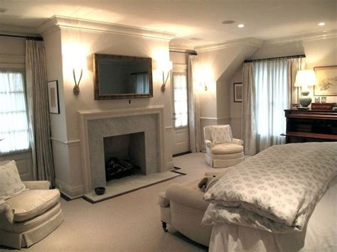 figless manor bedroom design with flatscreen tv marble fireplace two tone greige
