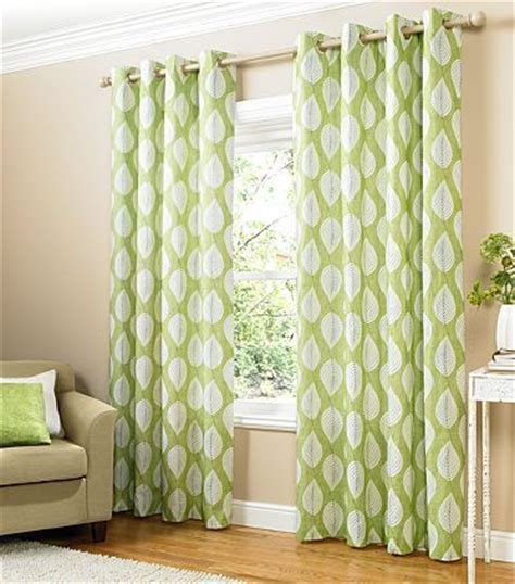 stylish green and white leaf print lined eyelet curtains