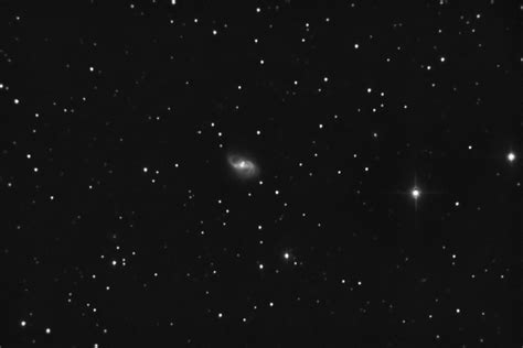 It is considered a grand design spiral galaxy and is classified as sb(s)b. NGC 2608