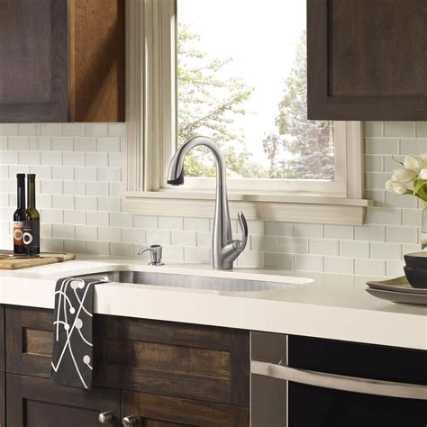white glass tile backsplash white countertop  dark