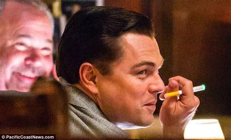 Leonardo Dicaprio Lights Up An Electronic Cigarette To Get