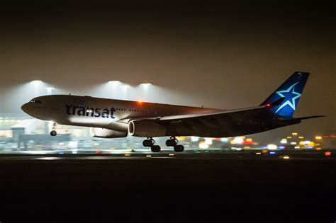 air transat depart montreal air transat brings 304 syrian refugees to montreal