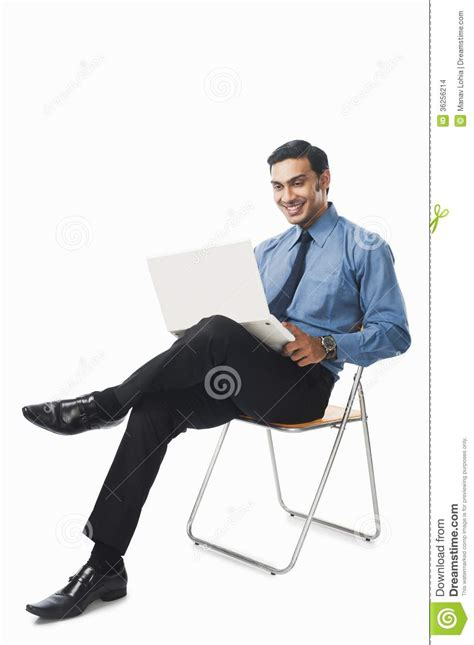 Bengali Businessman Using A Laptop On A Chair Stock Photo