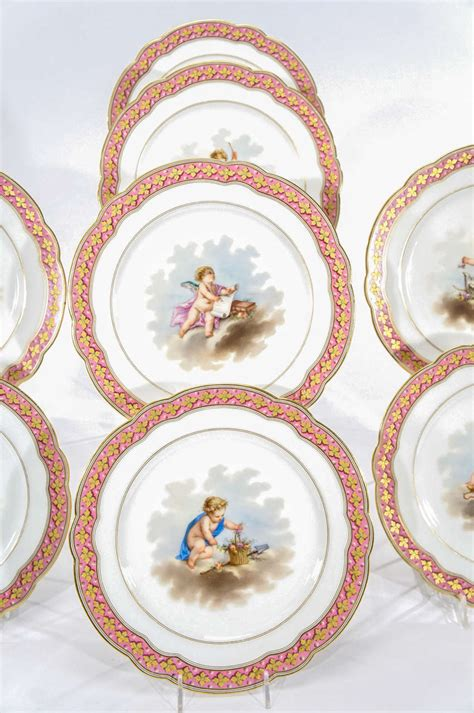 set of 10 choisy sevres style cabinet plates with putti