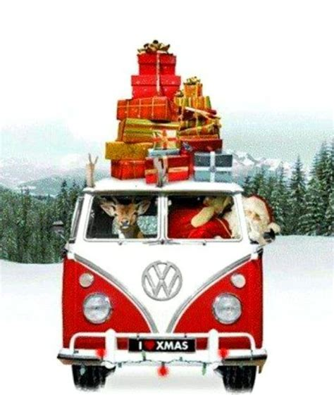 volkswagen christmas santa driving vw bus van with laden with christmas gifts