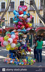 Street vendor selling balloons in the city of Puebla ...