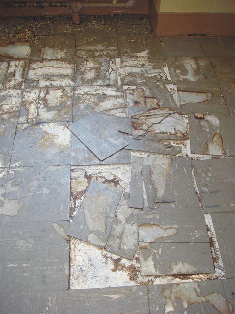 damaged asbestos floor tile basic   damaged