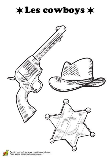 accesoire de cuisine coloriage pistolet etoile et chapeau de cow boy sur