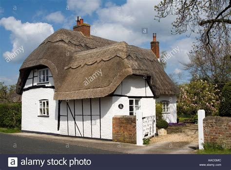 traditional cottage a typical traditional english country thatched house cottage with stock photo royalty free