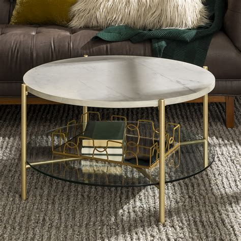 These tables are designed to occupy the center of your space. Manor Park Modern Round Coffee Table - White Marble Top, Glass Shelf, Gold Legs - Walmart.com