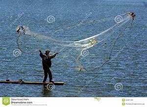 Fisherman Cast Net Fishing In Indonesia Stock Photo ...