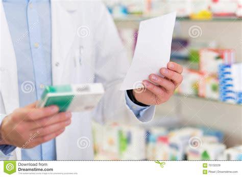 pharmacy ls for reading pharmacist reading prescription stock photo image 70132229